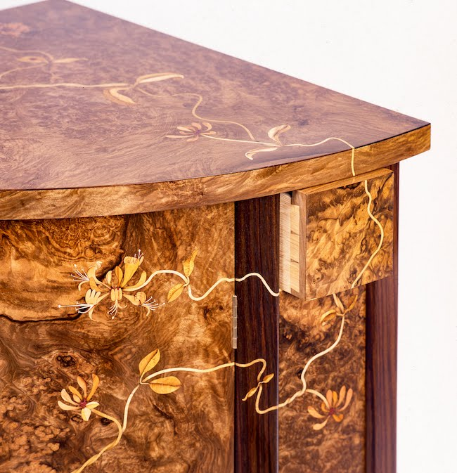 Honeysuckle marquetry on an award-winning corner cabinet